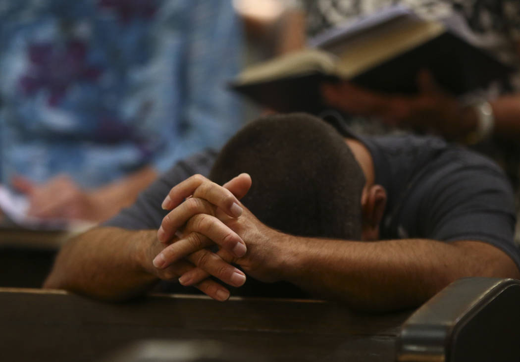 A man prays during a service led by The Rev. Barry Vaughn, Rector at Christ Church Episcopal in Las Vegas on Sunday, Oct. 8, 2017. Chase Stevens Las Vegas Review-Journal @csstevensphoto