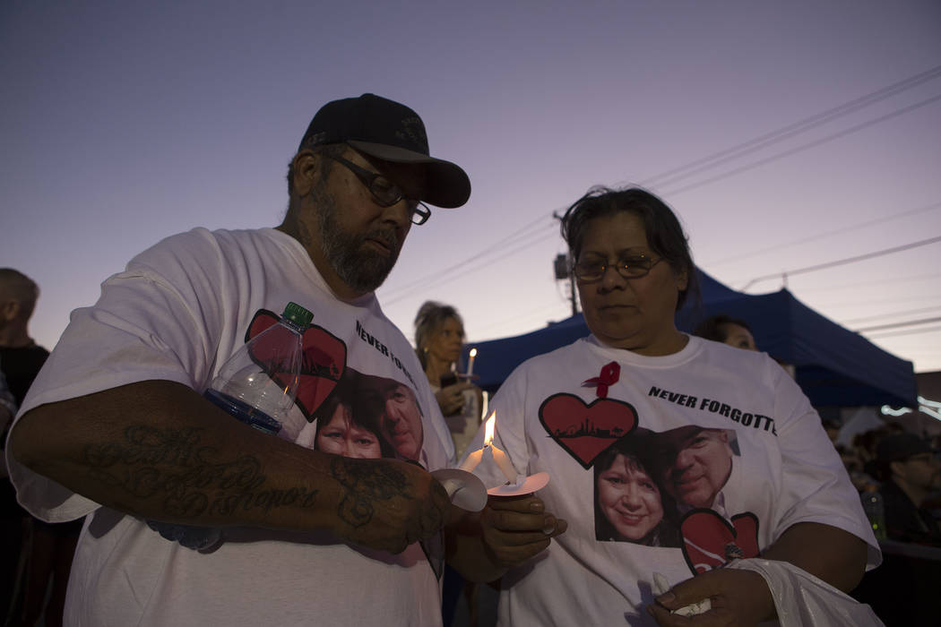 Edward Avila, left, helps light wife Glo Avila's candle during First Friday at Las Vegas, Friday, Oct. 6, 2017. This is the 15th anniversary of First Friday downtown Las Vegas. Bridget Bennett Las ...