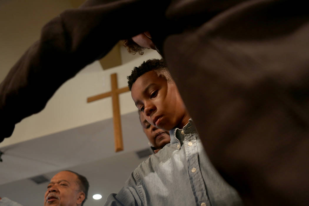 Kole Candley, 11, participates in a prayer during a First African-Methodist Episcopal Church service in North Las Vegas, Sunday, Oct. 8, 2017. Elizabeth Brumley Las Vegas Review-Journal @EliPagePhoto