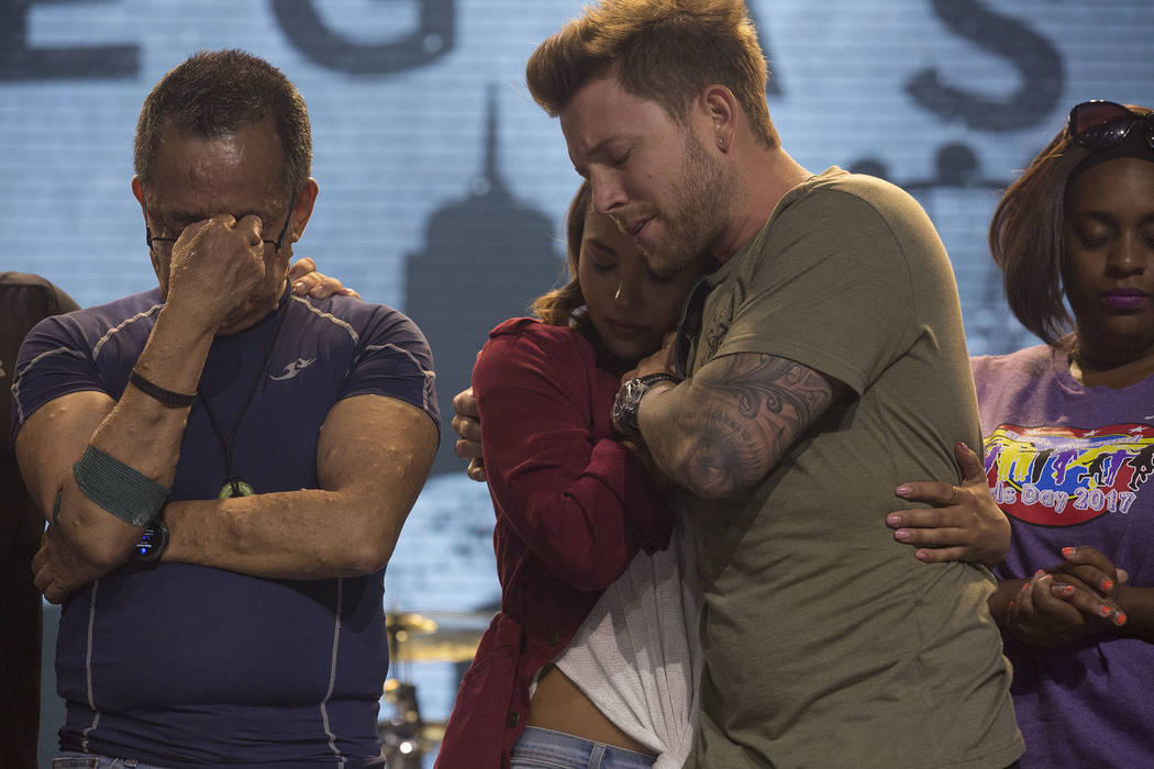 First responders embrace on stage during a service at Central Church in Henderson, Saturday, Oct. 7, 2017.  The service on Saturday evening was dedicated to first responders. Bridget Bennett Las V ...