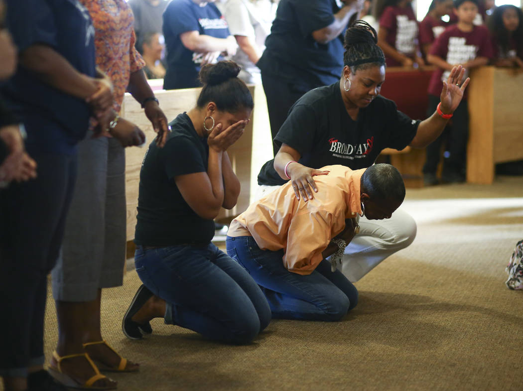 Roxana Valladares, left, reacts during a healing through celebration event at First African Methodist Episcopal Church in North Las Vegas on Sunday, Oct. 8, 2017. Chase Stevens Las Vegas Review-Jo ...