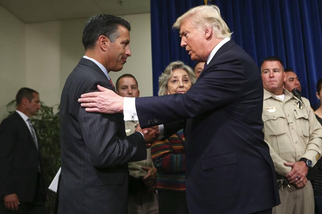 President Donald Trump embraces Nevada Gov. Brian Sandoval at Metropolitan Police Department headquarters in Las Vegas on Wednesday, Oct. 4, 2017. Chase Stevens Las Vegas Review-Journal @csstevens ...