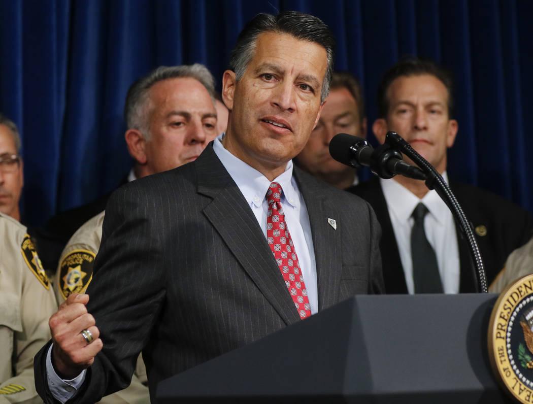 Gov. Brian Sandoval speaks at Metropolitan Police Department headquarters in Las Vegas on Wednesday, Oct. 4, 2017. Chase Stevens Las Vegas Review-Journal @csstevensphoto