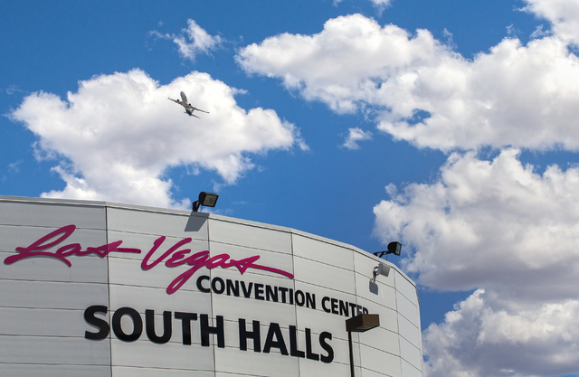 A commercial airliner from McCarran International Airport flies over the Las Vegas Convention Center's South Hall, Monday, May 16, 2016, in Las Vegas. (Benjamin Hager/Las Vegas Review-Journal)
