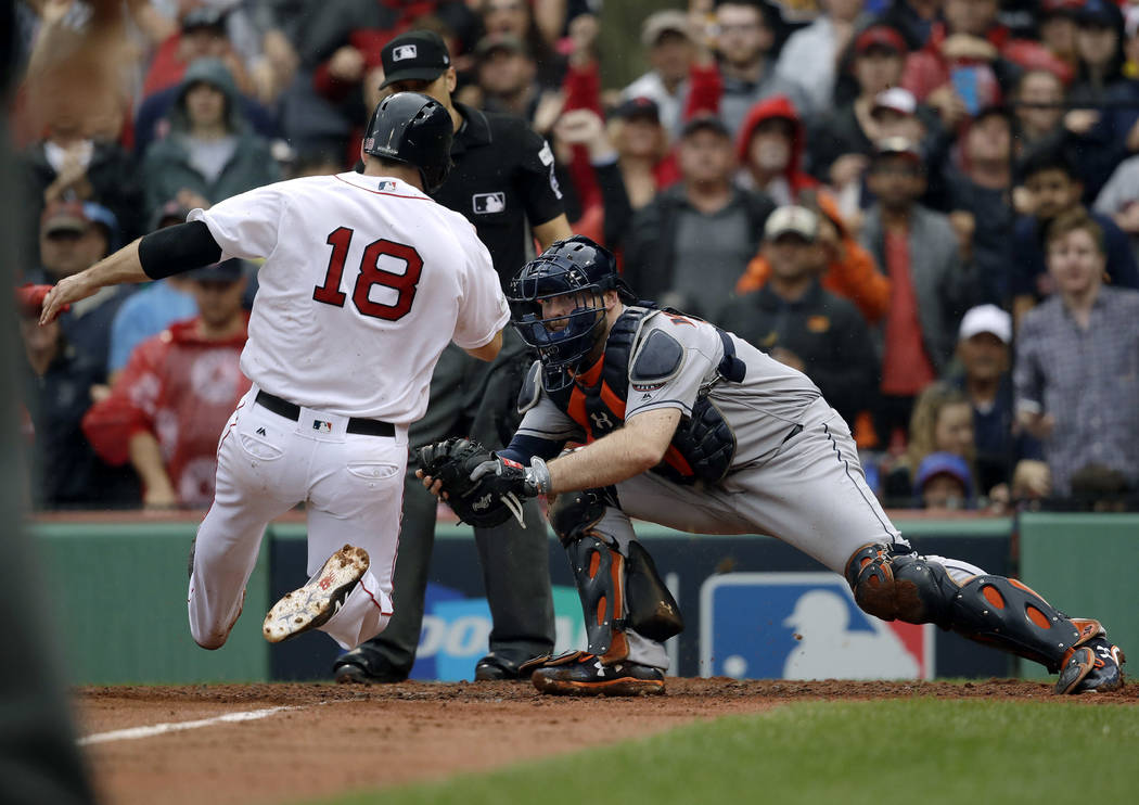 Houston Astros catcher Brian McCann, right, prepares to tag Boston Red Sox's Mitch Moreland out at home during the third inning in Game 4 of baseball's American League Division Series, Monday, Oct ...