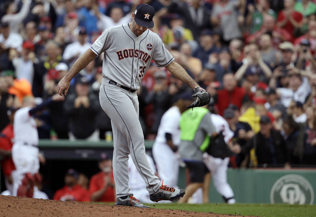 Houston Astros relief pitcher Justin Verlander reacts after giving up a two-run home run to Boston Red Sox's Andrew Benintendi during the fifth inning in Game 4 of baseball's American League Divis ...