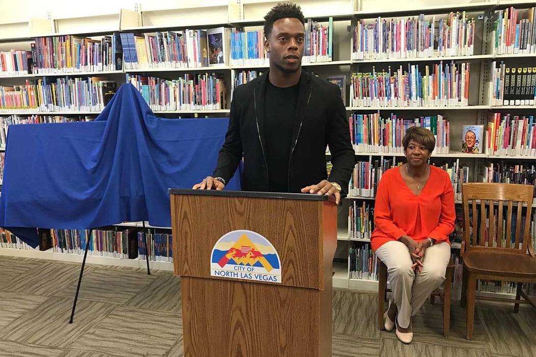 North Las Vegas Councilwoman Pamela Goynes-Brown watches as Broncos linebacker Brandon Marshall discusses his $5,000 donation Tuesday afternoon at the North Las Vegas Library. Art Marroquin Las Ve ...