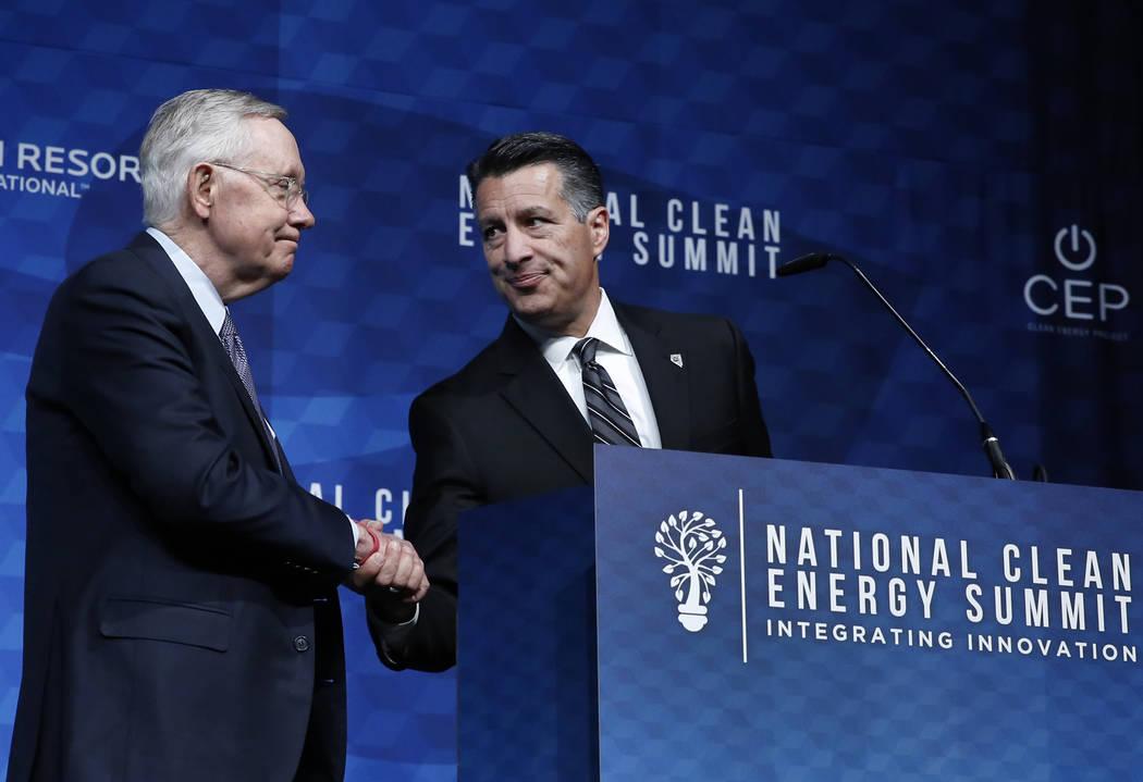 Gov. Brian Sandoval, right, introduces former U.S. Senate Harry Reid (D-Nev.) during the National Clean Energy Summit Friday, Oct. 13, 2017, in Las Vegas. Bizuayehu Tesfaye Las Vegas Review-Journa ...