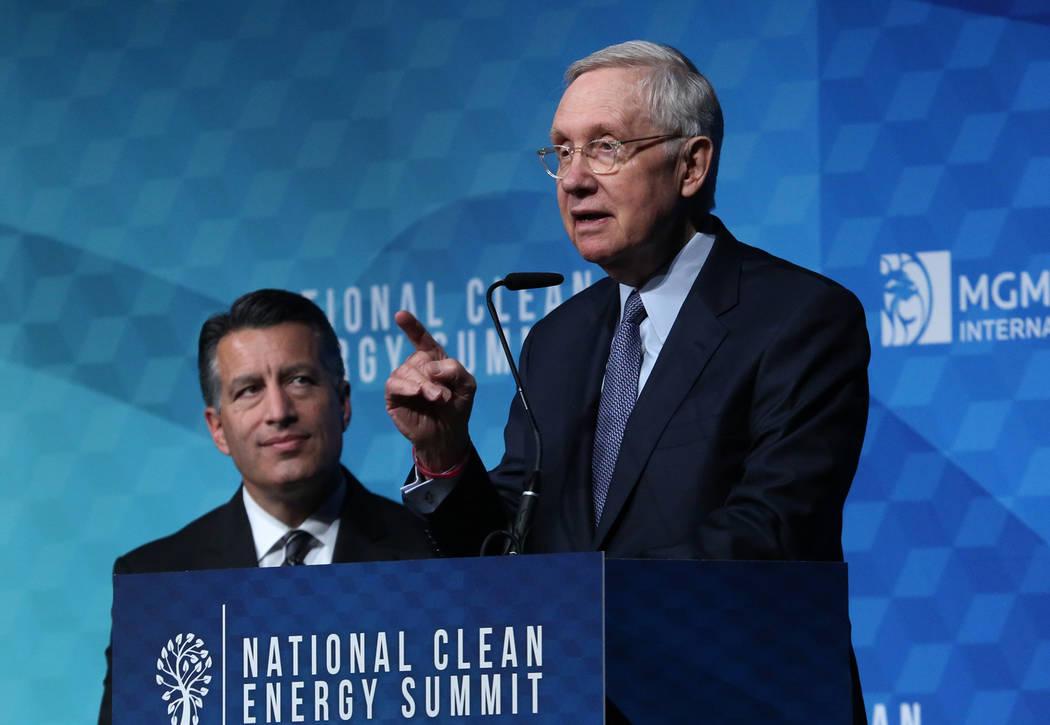 Former U.S. Senate Harry Reid (D-Nev.) speaks as Gov. Brian Sandoval looks on during the National Clean Energy Summit Friday, Oct. 13, 2017, in Las Vegas. Bizuayehu Tesfaye Las Vegas Review-Journa ...