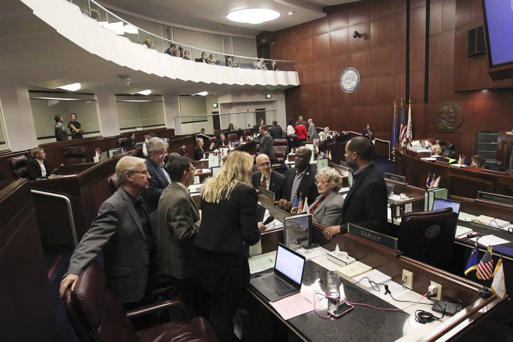 Senators confer during the second to last day of the Nevada Legislature at the Legislative Building in Carson City on Sunday, June 4, 2017. (Chase Stevens/Las Vegas Review-Journal) @csstevensphoto