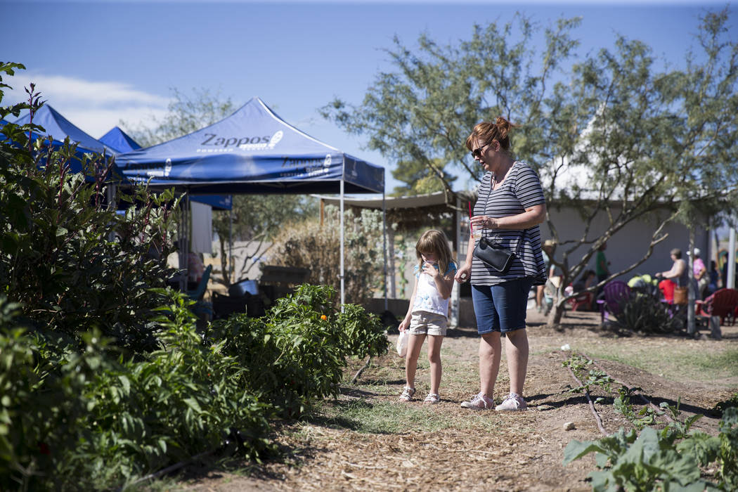 Las Vegas residents Paulie Hetzel with her granddaughter Ailita, 6, walk the community garden during the Grow Your Own Festival at the Vegas Roots Community Garden in Las Vegas, Saturday, Oct. 7,  ...