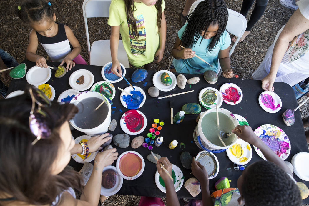 Children paint rocks during the Grow Your Own Festival at the Vegas Roots Community Garden in Las Vegas, Saturday, Oct. 7, 2017. Erik Verduzco Las Vegas Review-Journal @Erik_Verduzco