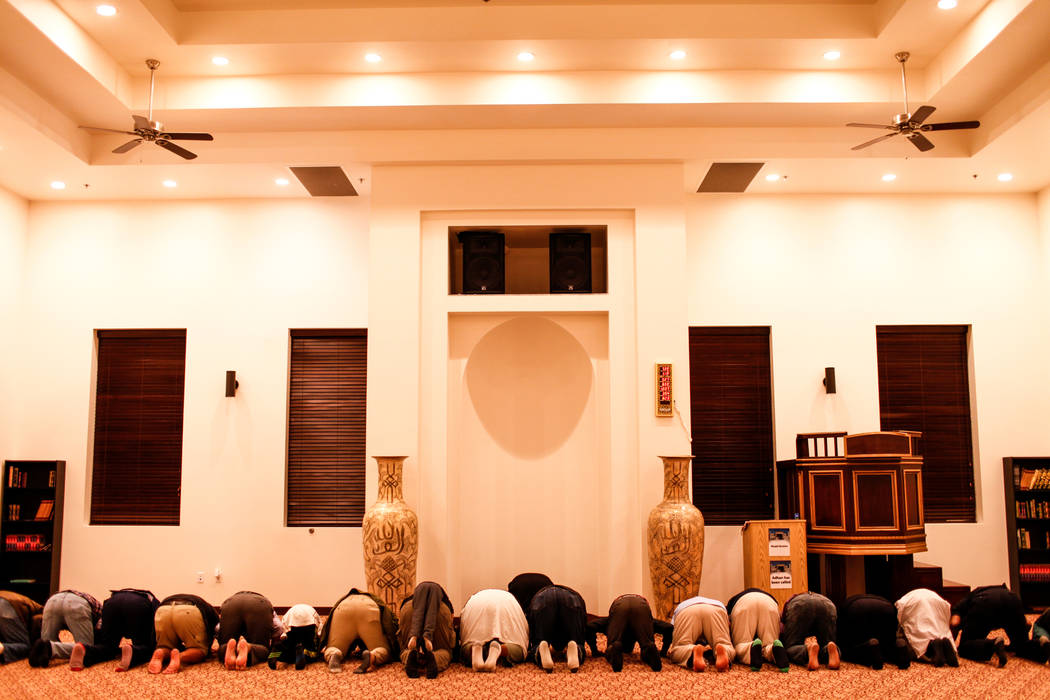 People gather during an evening prayer service at the Masjid Ibrahim mosque in Las Vegas, Monday, Oct. 9, 2017. The service was held in remembrance of the victims of last week's mass shooting at t ...
