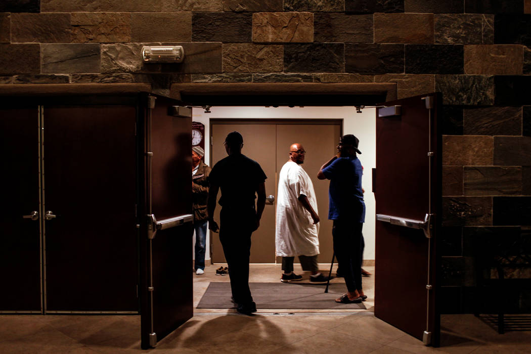 Mustafa Ibn Major of Las Vegas, 45, center, walks through a hall of the Masjid Ibrahim mosque in Las Vegas, Monday, Oct. 9, 2017. The mosque held a prayer service in remembrance of the victims of  ...