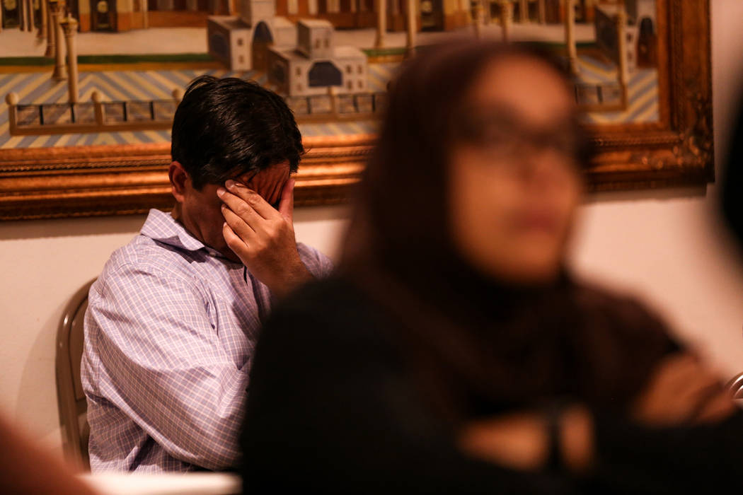 A man sits as he listens to a prayer service at the Masjid Ibrahim mosque in Las Vegas, Monday, Oct. 9, 2017. The service was held in remembrance of the victims of last week's mass shooting at the ...