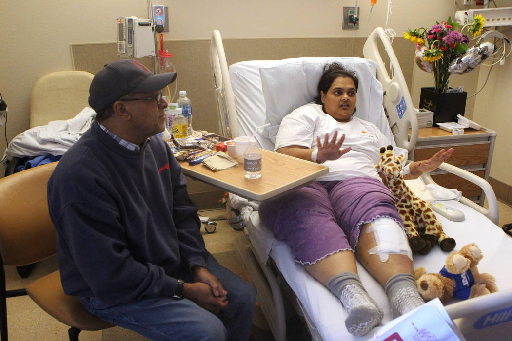 Samanta Arjune, who was shot during the Route 91 Harvest festival Oct. 1, tells her story of survival and recovery during an interview at University Medical Center Monday, Oct. 9, 2017. At left is ...