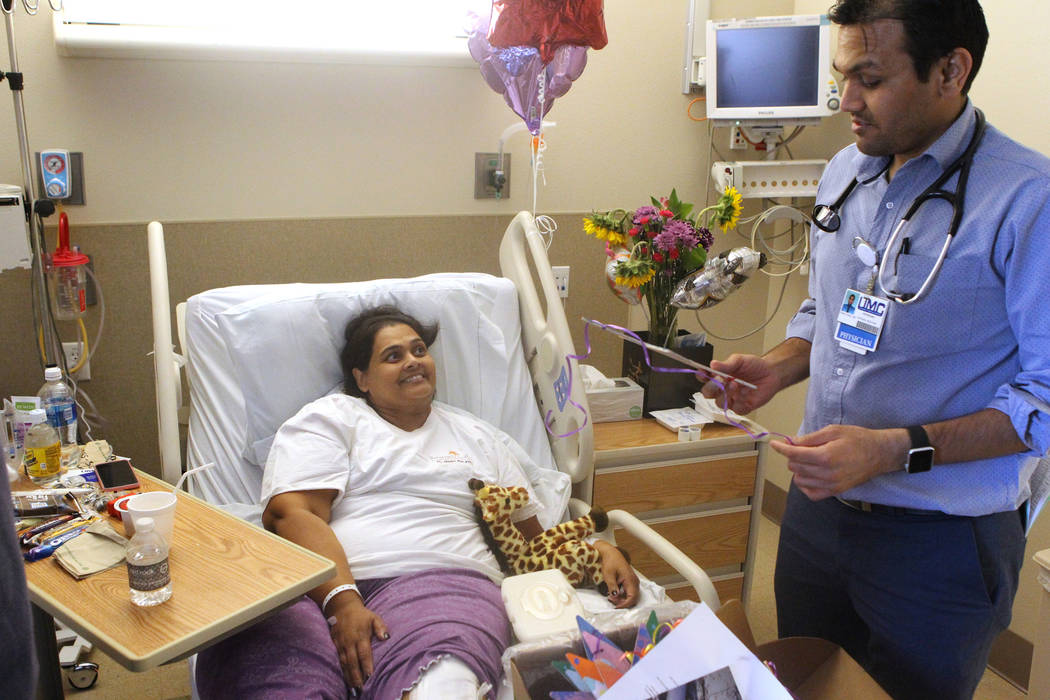 "Samanta Arjune, who was shot during the Route 91 Harvest festival Oct. 1, talks to her ""knight in shinning armor"" Dr. Pinak Shah at University Medical Center Monday, Oct. 9, 2017 ..."