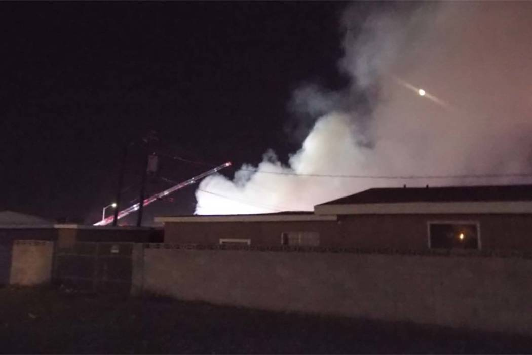 Smoke billows from a fire at a vacant house in central Las Vegas. (Mas Michor/review-Jouranl