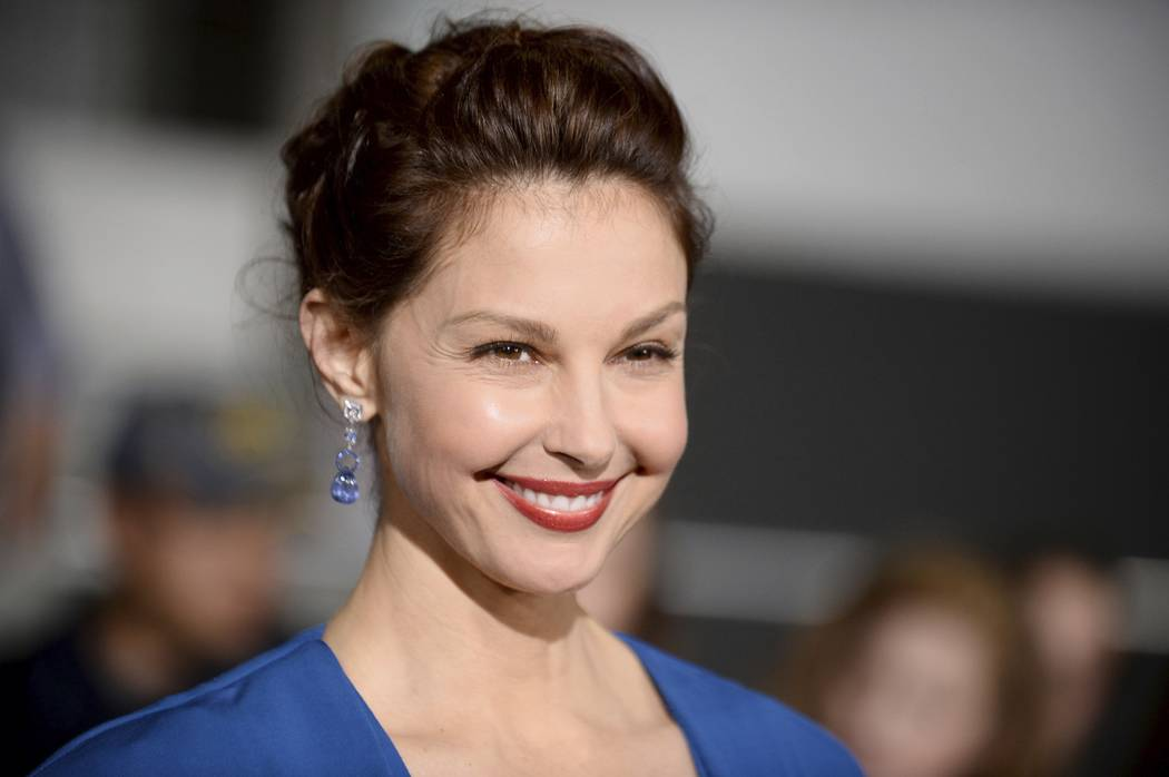 "Ashley Judd arrives at the March 18, 2014 world premiere of ""Divergent"" at the Westwood Regency Village Theater in Los Angeles. The New York Times article chronicled allegations against Weinstein  ..."