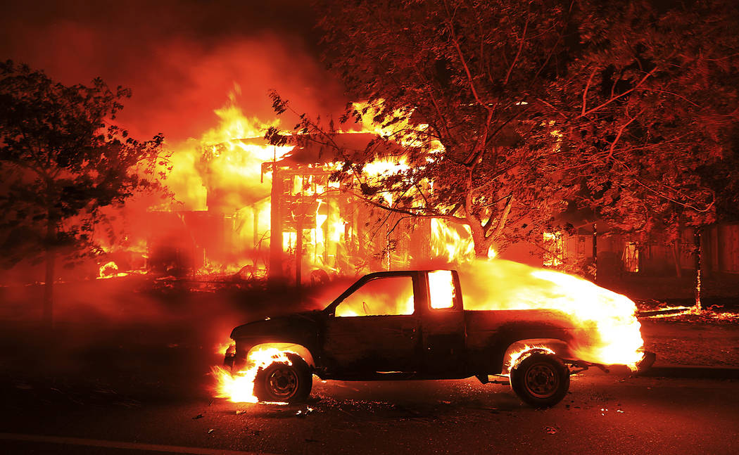 Coffey Park homes burn early Monday Oct. 9, 2017 in Santa Rosa, Calif. More than a dozen wildfires whipped by powerful winds been burning though California wine country. The flames have destroyed  ...
