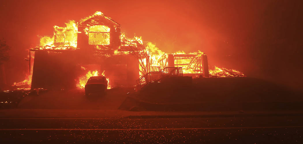 A home burns in Fountaingrove, Monday Oct. 9, 2017 in Santa Rosa, Calif. More than a dozen wildfires whipped by powerful winds been burning though California wine country. The flames have destroye ...