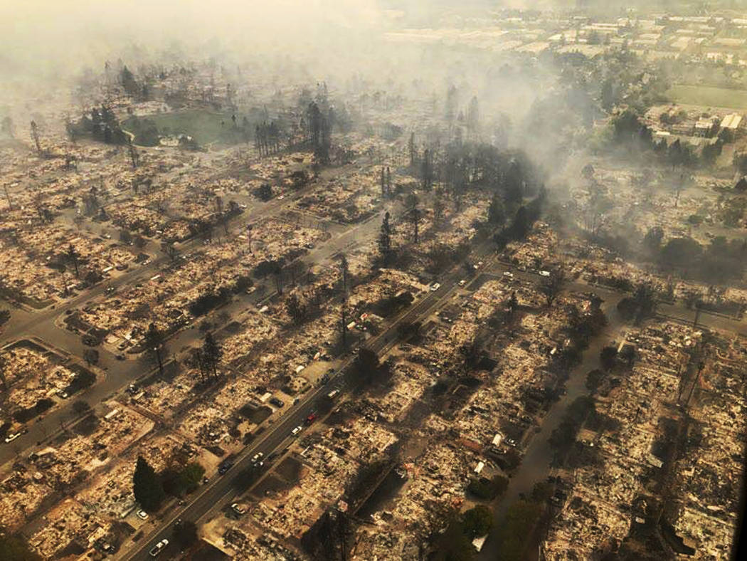 This aerial photo provided by the California Highway Patrol Golden Gate Division shows some of hundreds of homes destroyed in a wind-driven wildfire that swept through Santa Rosa, Calif., early Mo ...