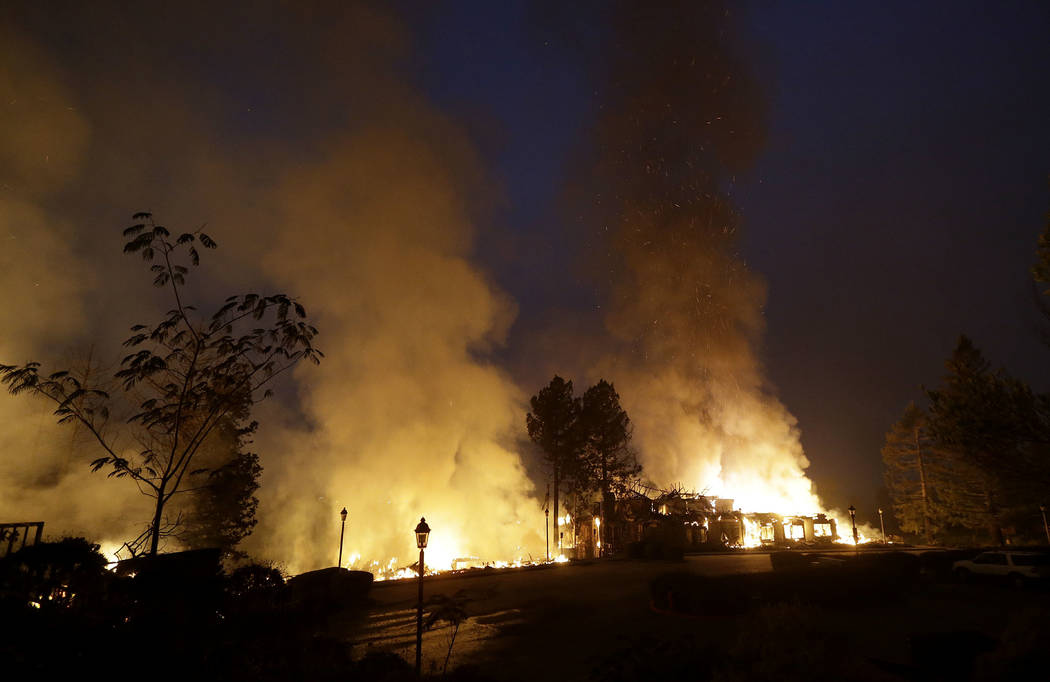 Smoke and flames from fire at the Hilton Sonoma Wine Country hotel in Santa Rosa, Calif., Monday, Oct. 9, 2017. (AP Photo/Jeff Chiu)