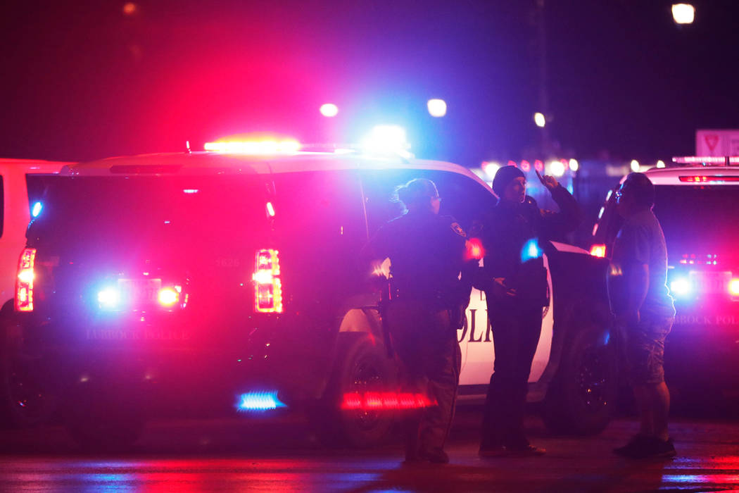 Emergency personnel stage at an intersection across from Talkington Hall on the Texas Tech University campus  in Lubbock, Texas, Monday, Oct. 9, 2017. Police apprehended a 19-year-old student accu ...