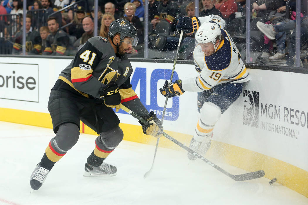Vegas Golden Knights left wing Pierre-Edouard Bellemare (41) and Buffalo Sabres defenseman Jake McCabe (19) fight for the puck during a game at T-Mobile Arena in Las Vegas, Tuesday, Oct. 17, 2017. ...