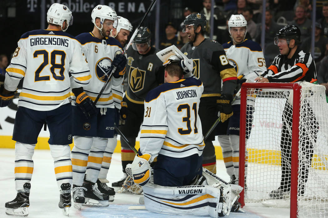 Buffalo Sabres goalie Chad Johnson (31) grabs his head after his helmet is knocked off during a game against Vegas Golden Knights at T-Mobile Arena in Las Vegas, Tuesday, Oct. 17, 2017. Bridget Be ...