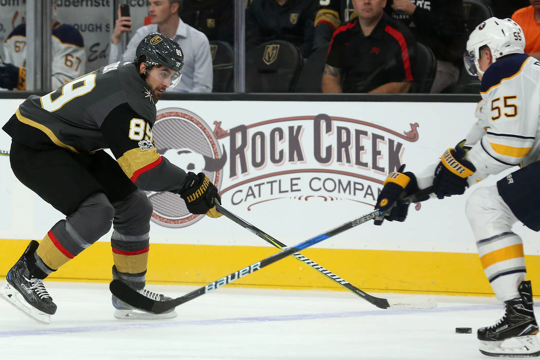 Vegas Golden Knights right wing Alex Tuch (89) and Buffalo Sabres defenseman Rasmus Ristolainen (55) fight for the puck during a game at T-Mobile Arena in Las Vegas, Tuesday, Oct. 17, 2017. Bridge ...