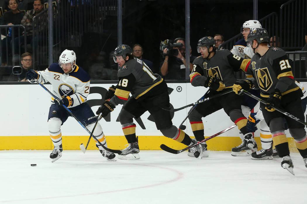 Buffalo Sabres center Johan Larsson (22) bring the puck up the ice while Vegas Golden Knights players trail behind him during a game at T-Mobile Arena in Las Vegas, Tuesday, Oct. 17, 2017. Bridget ...