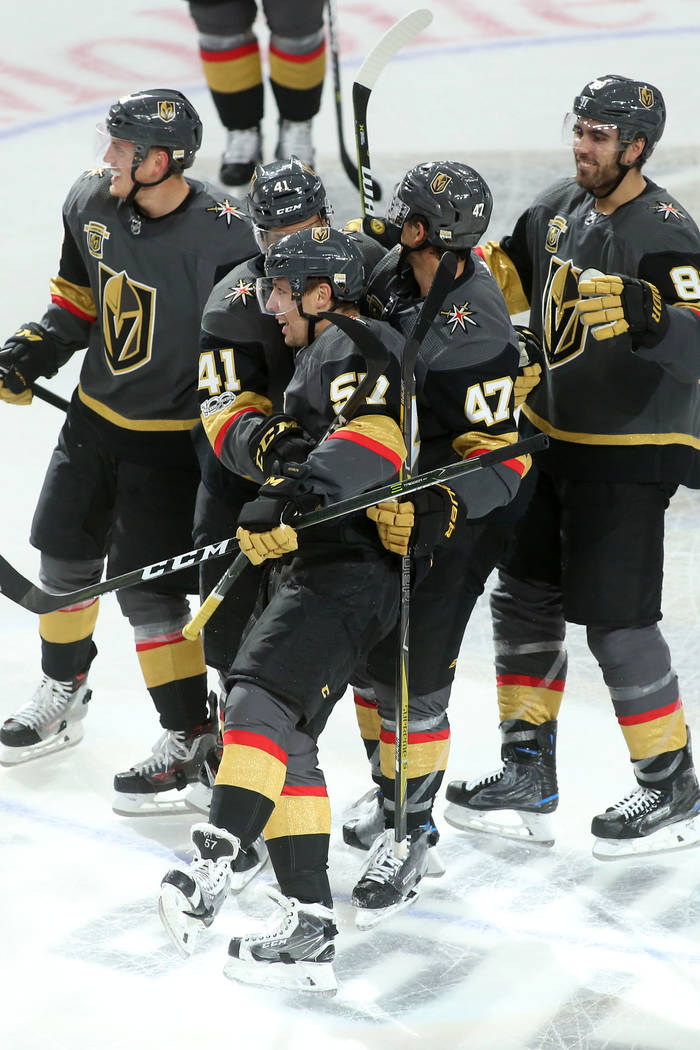 Vegas Golden Knights players embrace left wing David Perron (57) after Perron's game winning goal over Buffalo Sabres at T-Mobile Arena in Las Vegas, Tuesday, Oct. 17, 2017. Vegas Golden Knights w ...