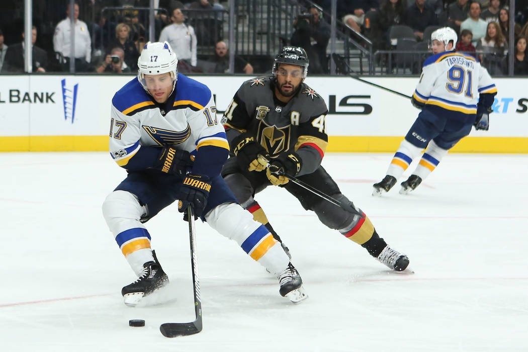 St. Louis Blues left wing Jaden Schwartz (17) and Vegas Golden Knights left wing Pierre-Edouard Bellemare (41) fight for the puck during a game at T-Mobile Arena in Las Vegas, Saturday, Oct. 21, 2 ...