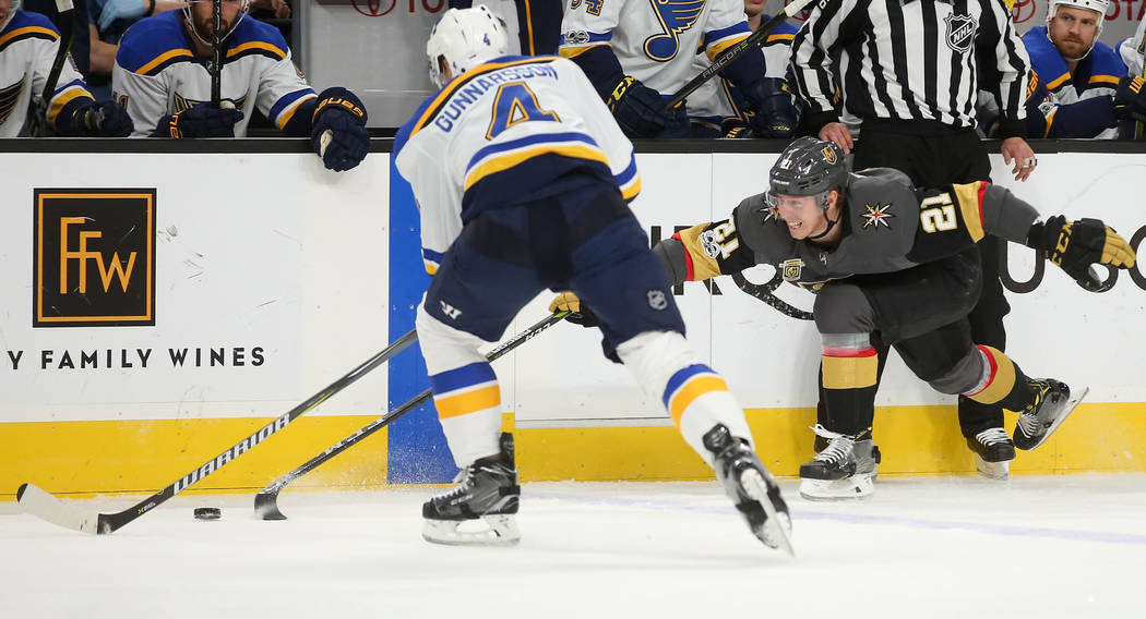 Vegas Golden Knights center Cody Eakin (21) fights against St. Louis Blues defenseman Carl Gunnarsson (4)  for the puck during a game at T-Mobile Arena in Las Vegas, Saturday, Oct. 21, 2017. Bridg ...