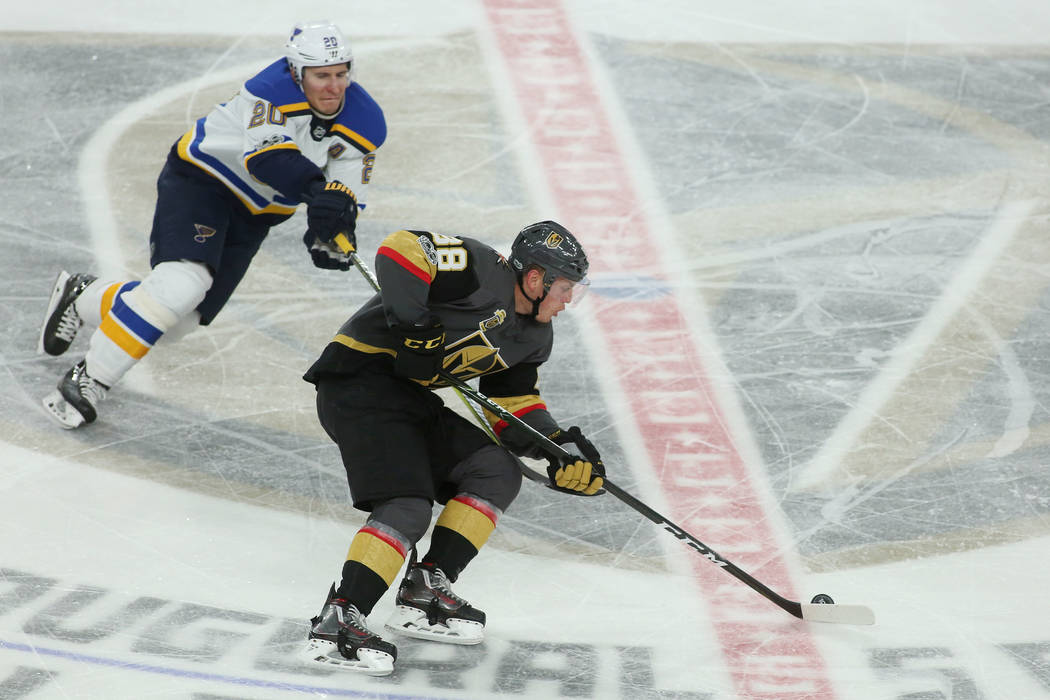 St. Louis Blues left wing Alexander Steen (20) tries to get the puck from Vegas Golden Knights defenseman Nate Schmidt (88) during the second period of the game at T-Mobile Arena in Las Vegas, Sat ...