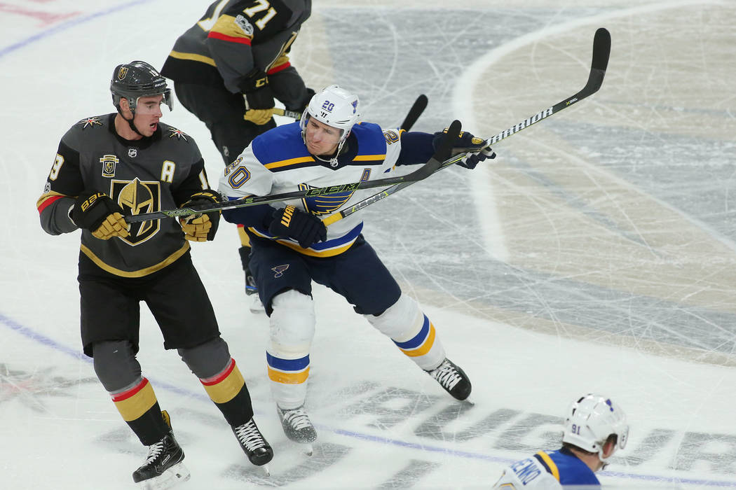 St. Louis Blues left wing Alexander Steen (20) shoves Vegas Golden Knights right wing Reilly Smith (19) during the second period of the game at T-Mobile Arena in Las Vegas, Saturday, Oct. 21, 2017 ...