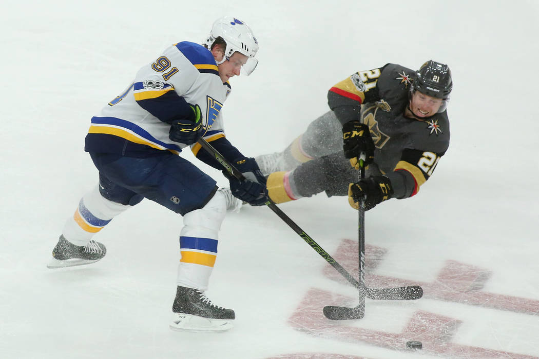 Vegas Golden Knights center Cody Eakin (21) falls to the ice while fighting for the puck against St. Louis Blues right wing Vladimir Tarasenko (91) during the second period of the game at T-Mobile ...