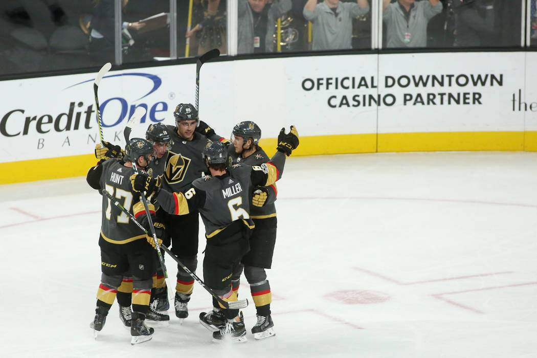 Vegas Golden Knights players come together in celebration of a goal during the second period of the game at T-Mobile Arena against St. Louis Blues in Las Vegas, Saturday, Oct. 21, 2017. Bridget Be ...