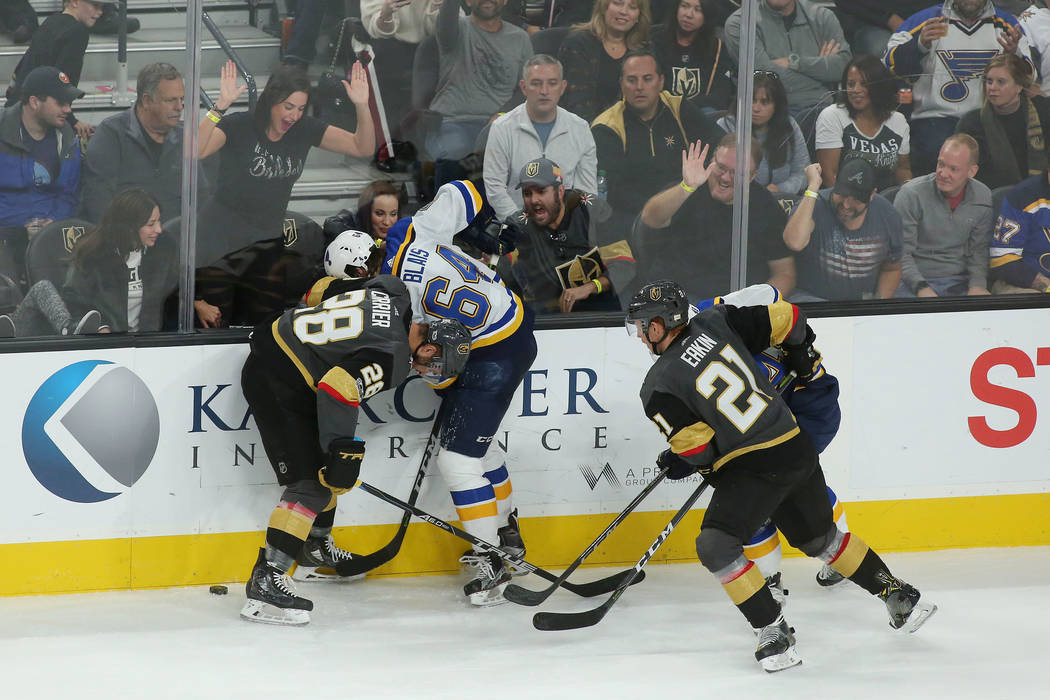 St. Louis Blues and Vegas Golden Knights players fight for the puck while fans bang on the glass during the second period of the game at T-Mobile Arena in Las Vegas, Saturday, Oct. 21, 2017. Bridg ...