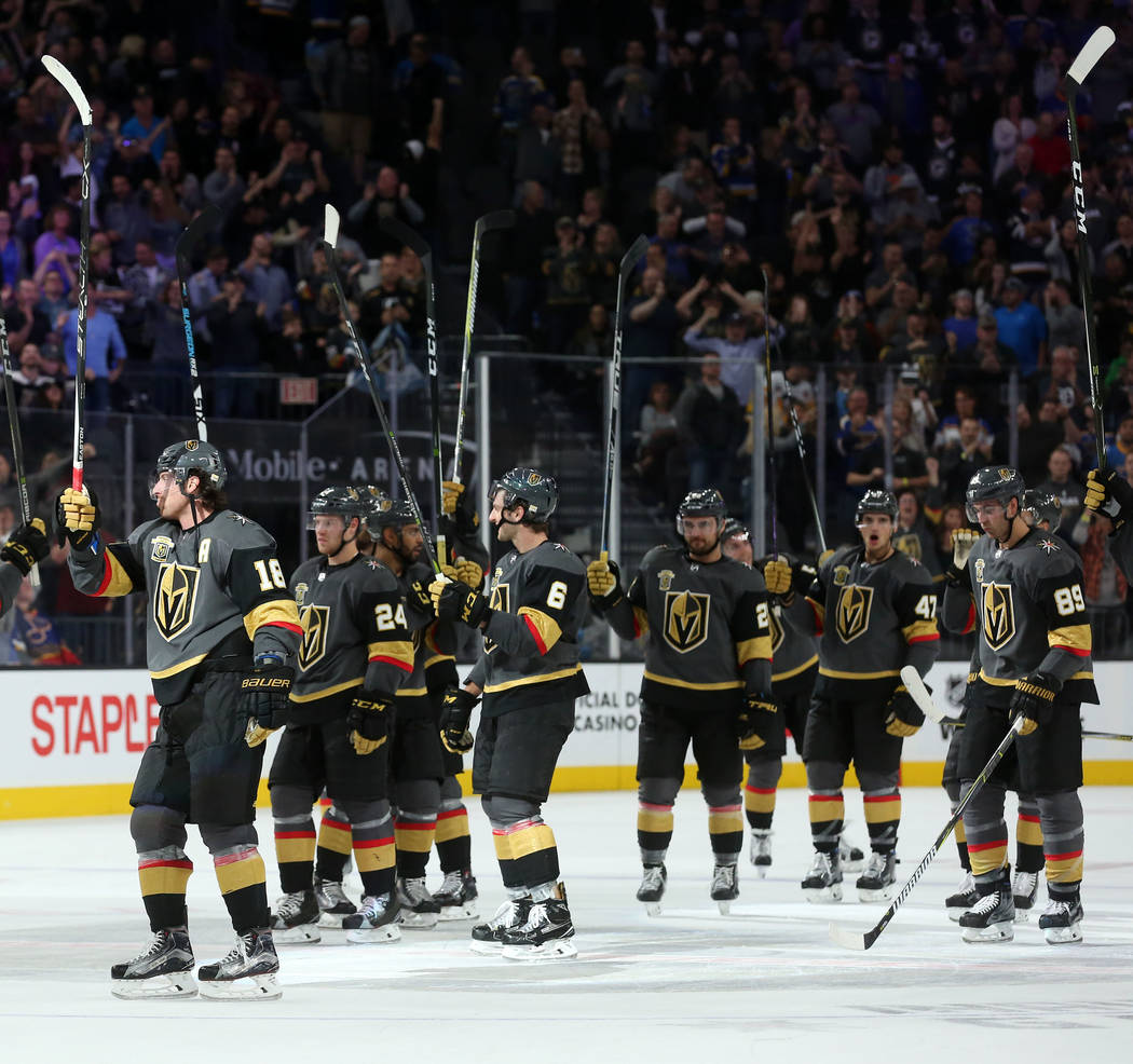 Vegas Golden Knights players hold up their sticks after their 3-2 win over St. Louis Blues in overtime at T-Mobile Arena in Las Vegas, Saturday, Oct. 21, 2017. Bridget Bennett Las Vegas Review-Jou ...