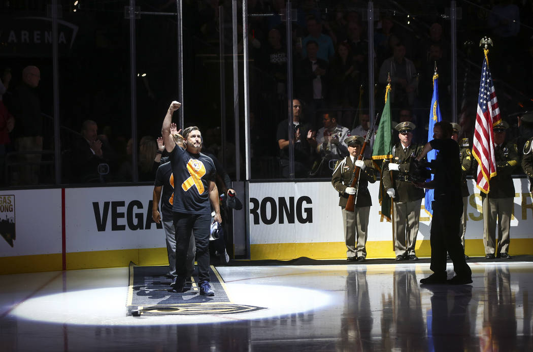 Members of the Route 91 festival team are introduced before an NHL hockey game between the Vegas Golden Knights and Arizona Coyotes at T-Mobile Arena in Las Vegas on Tuesday, Oct. 10, 2017. Chase  ...