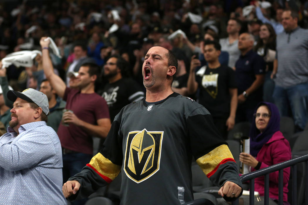 A Vegas Golden Knights fan cheers during the third period against the Arizona Coyotes at T-Mobile Arena in Las Vegas, Tuesday, Oct. 10, 2017. Knights won 5-2. Bridget Bennett Las Vegas Review-Jour ...