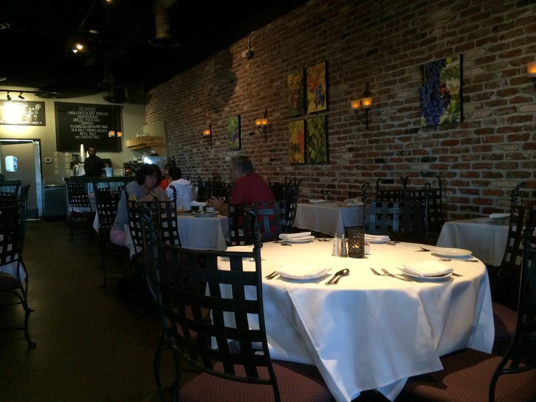 The interior of Grape Vine Café, Wine Bar & Cellar is seen Oct. 9, 2017. The feature wall is all brick and wrought iron accents are used to offer a Mediterranean feel. (Jan Hogan/View)