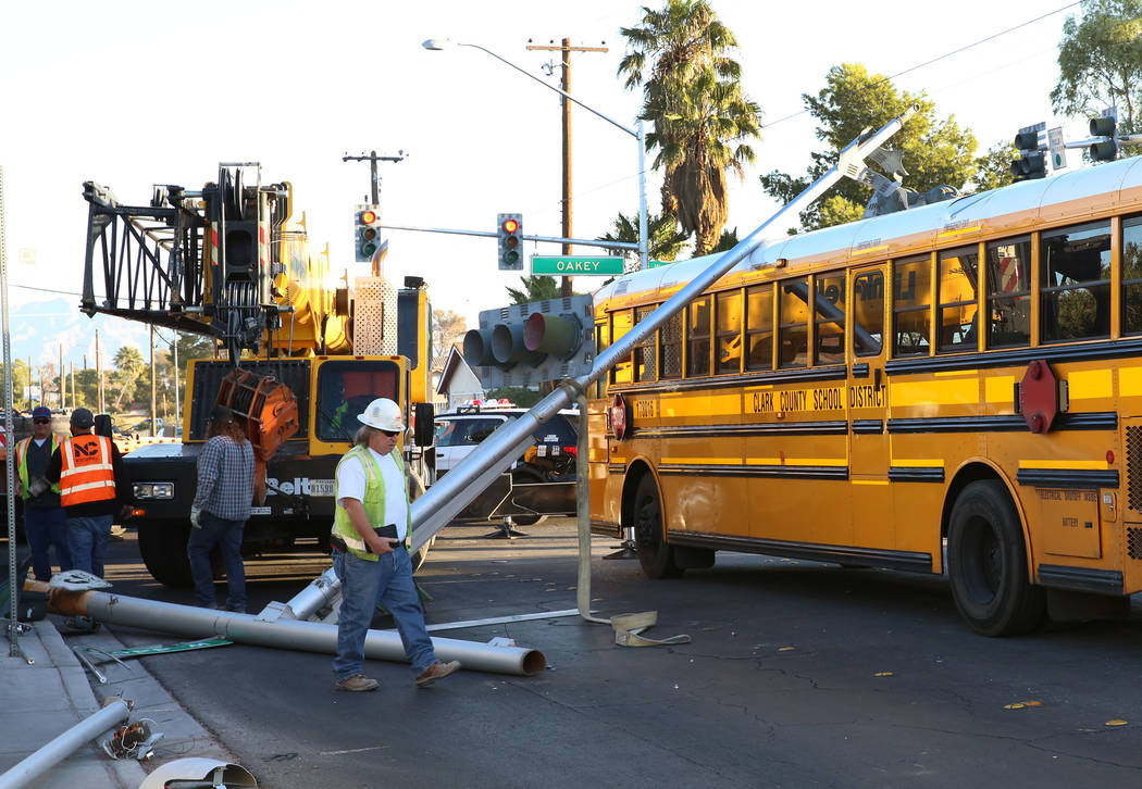 A crane truck hit a street light and the pole fell on a Clark County School District bus at Arville Street and Oakey Boulevard, Tuesday, Oct. 10, 2017, in Las Vegas. Bizuayehu Tesfaye Las Vegas Re ...