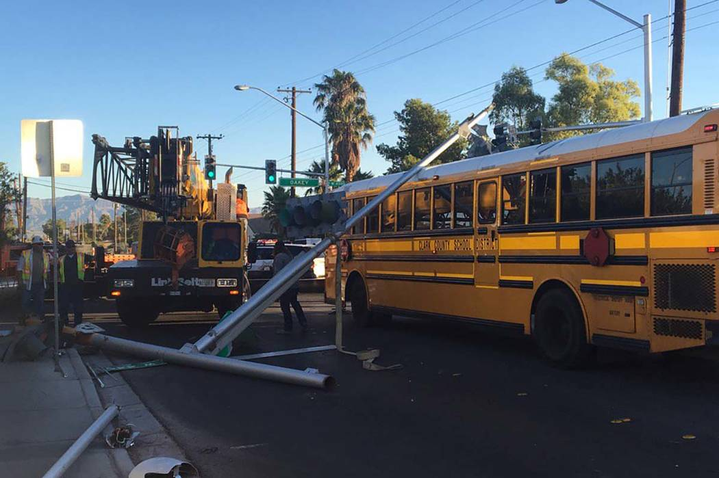 A crane truck hit a street light and the pole fell on a Clark County School District bus at Arville Street and Oakey Boulevard, Tuesday, Oct. 10, 2017. (Bizuayehu Tesfaye/Las Vegas Review-Journal) ...