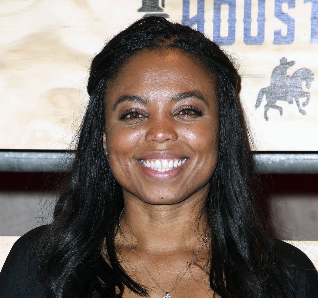 In this Feb. 3, 2017, file photo, Jemele Hill attends ESPN: The Party 2017 in Houston, Texas. ESPN anchor Jemele Hill has been suspended by the network for two weeks for making political statement ...