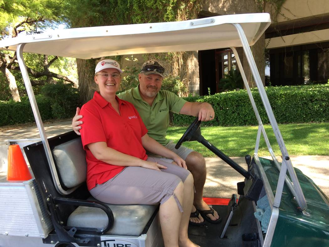 Paul and Kristin Schulz get set for a ride on a golf cart at TPC Summerlin Sept. 18, 2017. The couple has been volunteering with Shriner's Open for years and plan their vacation times around the ...
