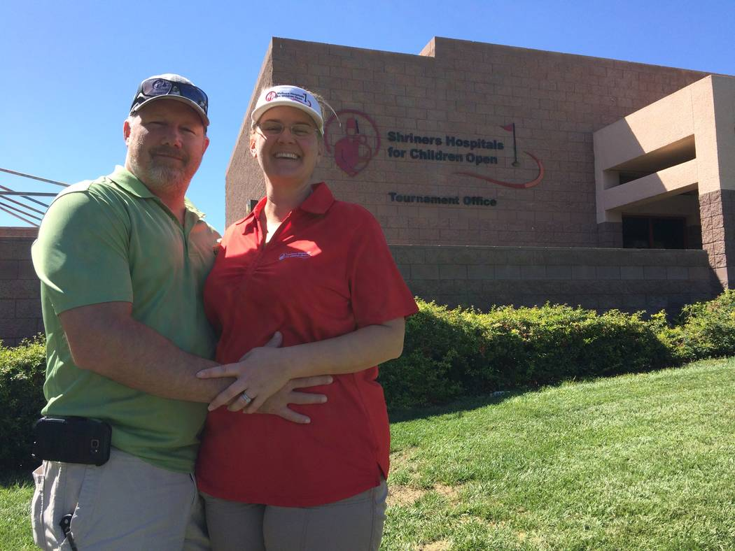 Paul and Kristin Schulz pause outside the Shriner's building at TPC Summerlin Sept. 18, 2017. The couple has been volunteering with Shriner's Open for years and plan their vacation times aroun ...