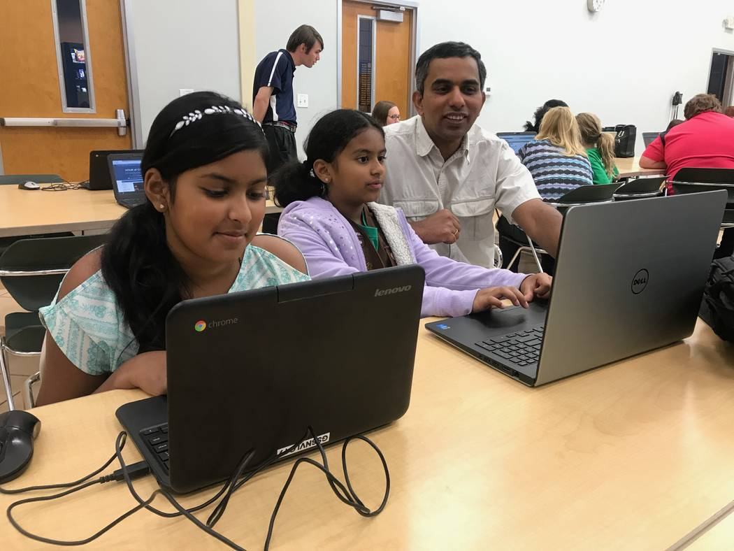 Girl Scouts Savia and Sonel practice coding activities with their father on Oct. 9, 2017 at the Girl Scouts of Southern Nevada headquarters, 2941 E. Harris Ave. (Kailyn Brown/View) @KailynHype